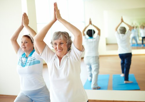 Elderly woman in an exercise class.