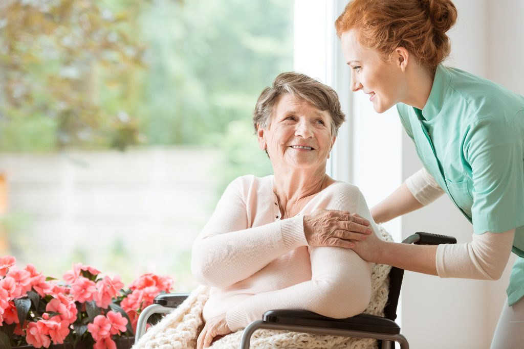Senior Advisor helping female patient