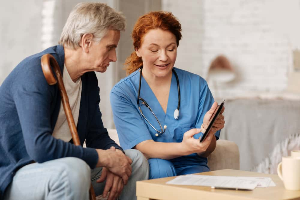 Homecare worker showing patient information
