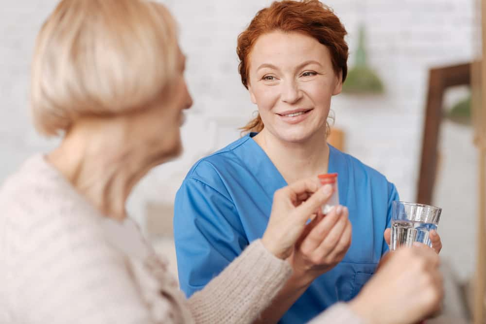 Caregiver giving client medication
