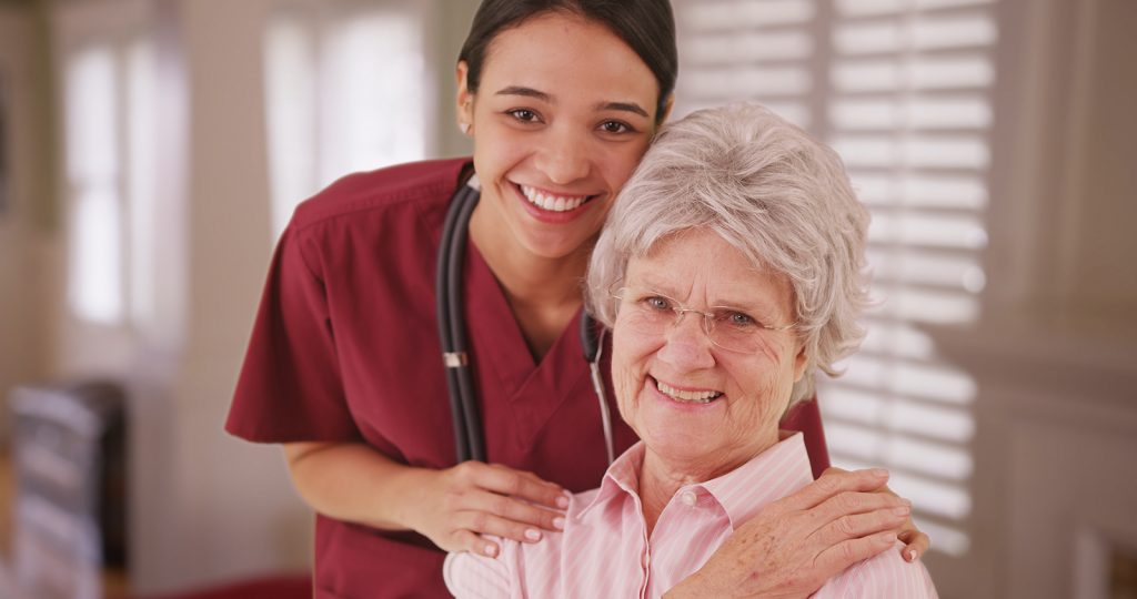 Home care worker with senior aged woman