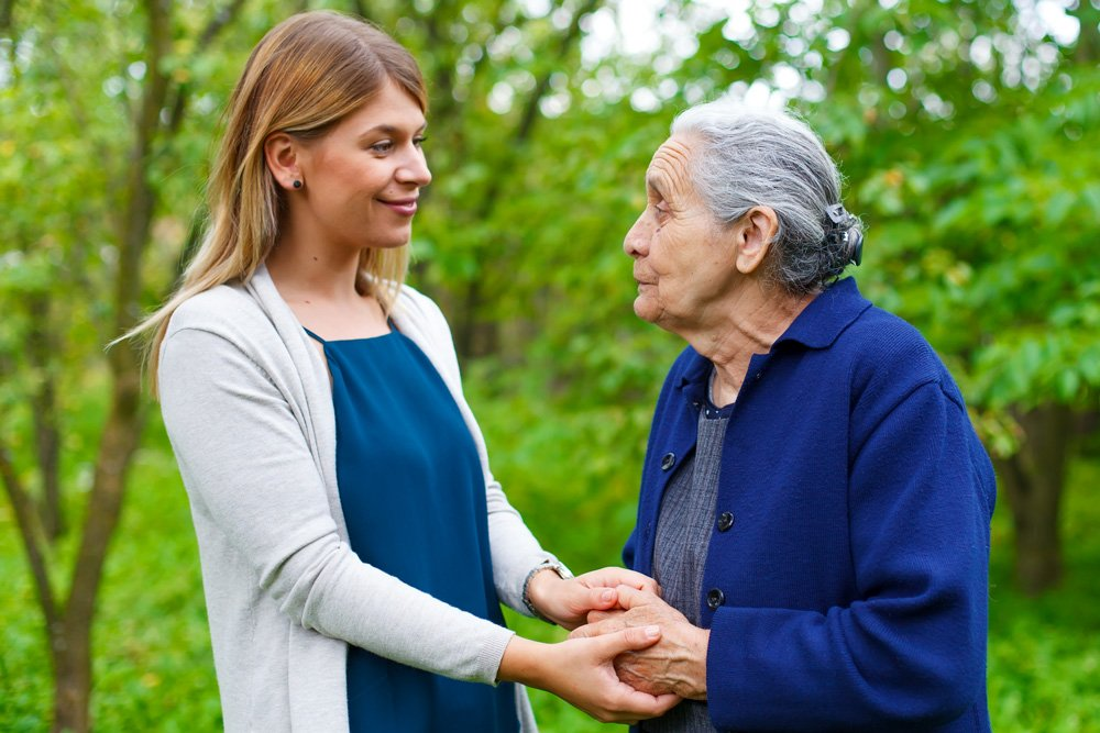Woman caregiver with elderly patient with alzheimers