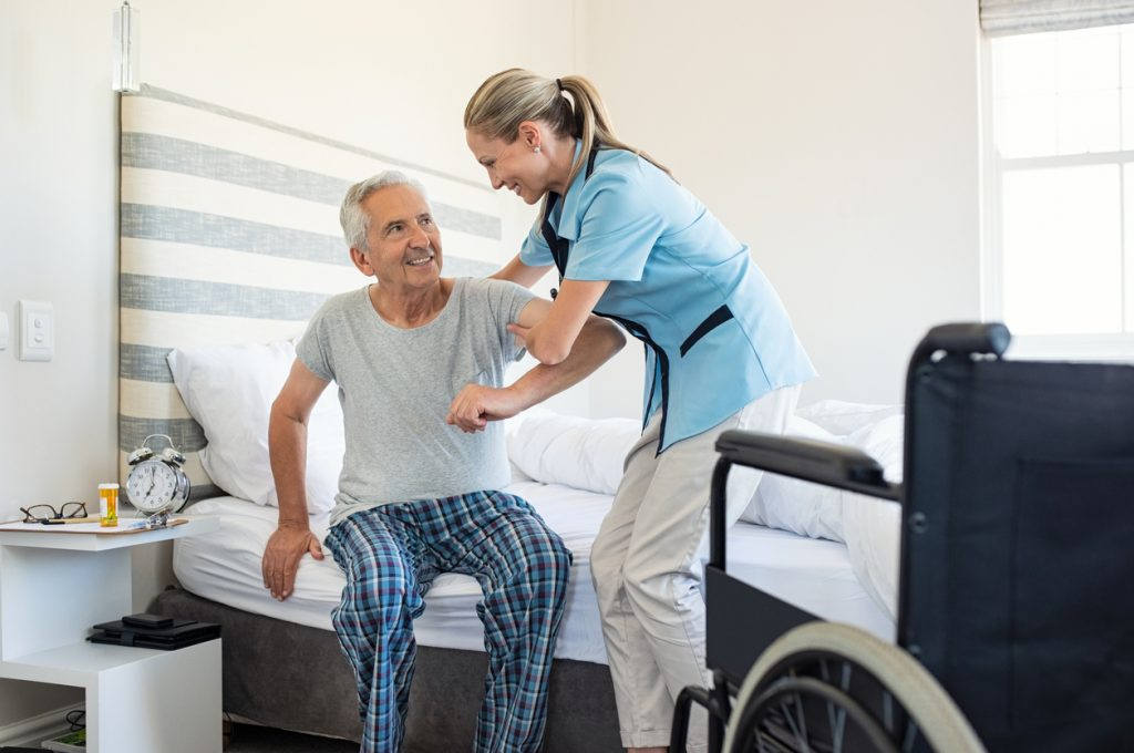 Elderly Man Assisted By A Home Health Aide