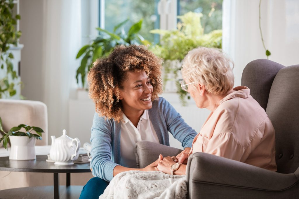 Nurse Talking With An Elderly Woman